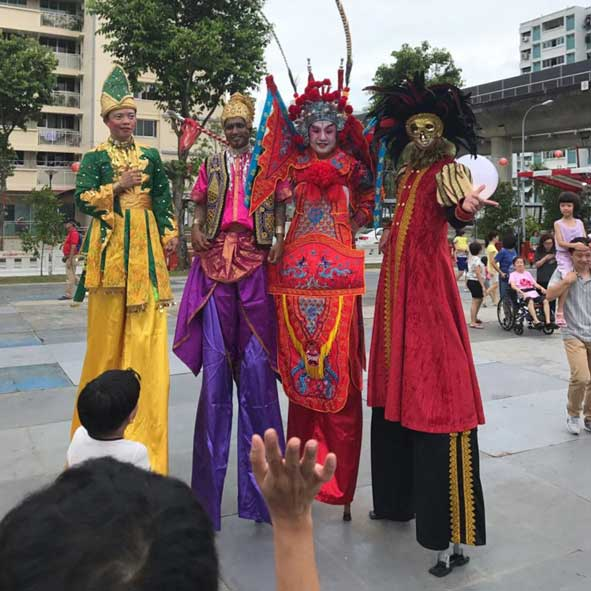 singapore-event-management-pre-event-fringe-activities-multi-racial-stilt-walkers