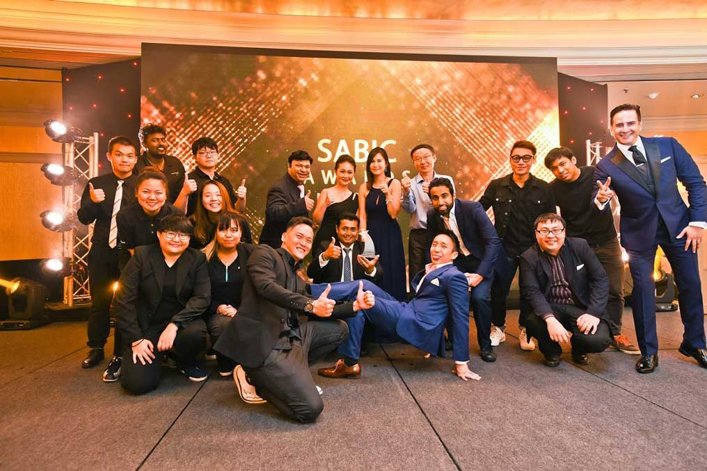 Event company in Singapore team photo with client