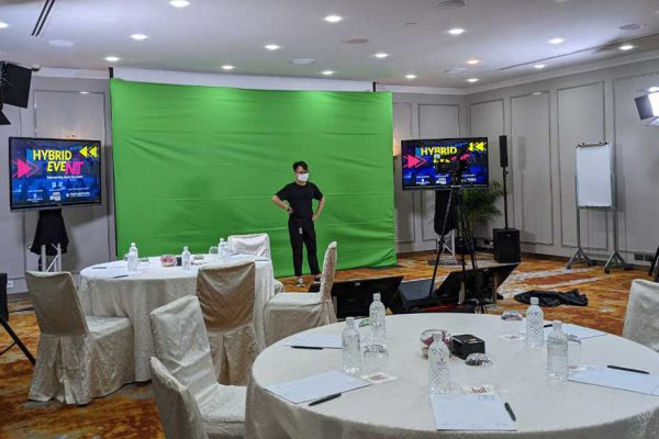 Orchard hotel meeting with green screen backdrop